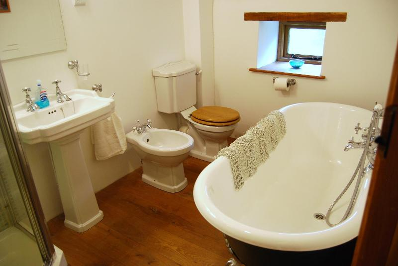 The ensuite for bedroom one with roll-top bath, bidet and shower. A real luxury experience!