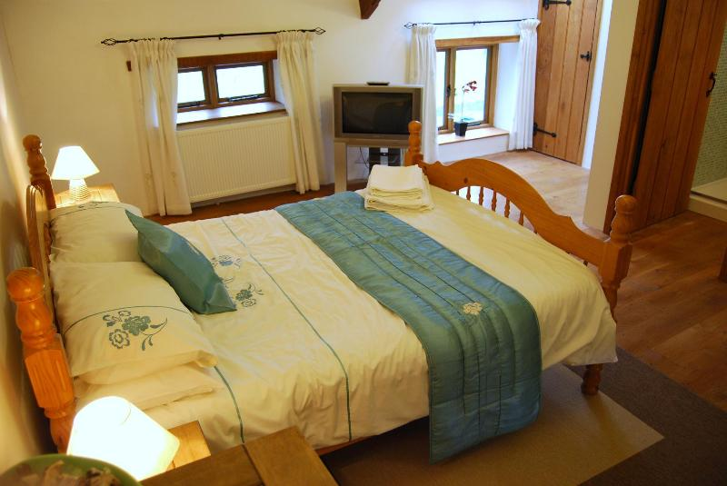 Bedroom one is a very large luxury room that promises a good night's sleep.