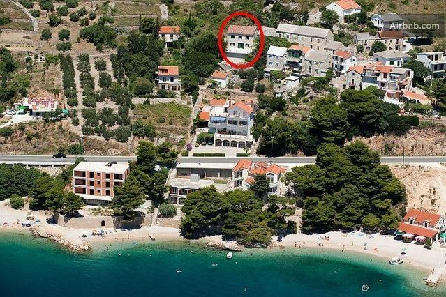 Villa Lucija from air, pebble beach with pine trees