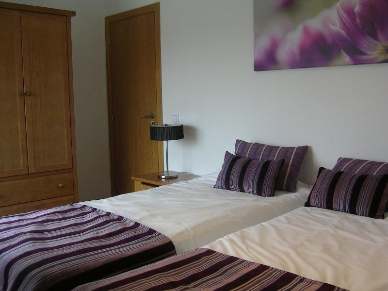 Comfy twin beds, crisp white sheets, air conditioned for your comfort, double wardrobe,  trendy rug