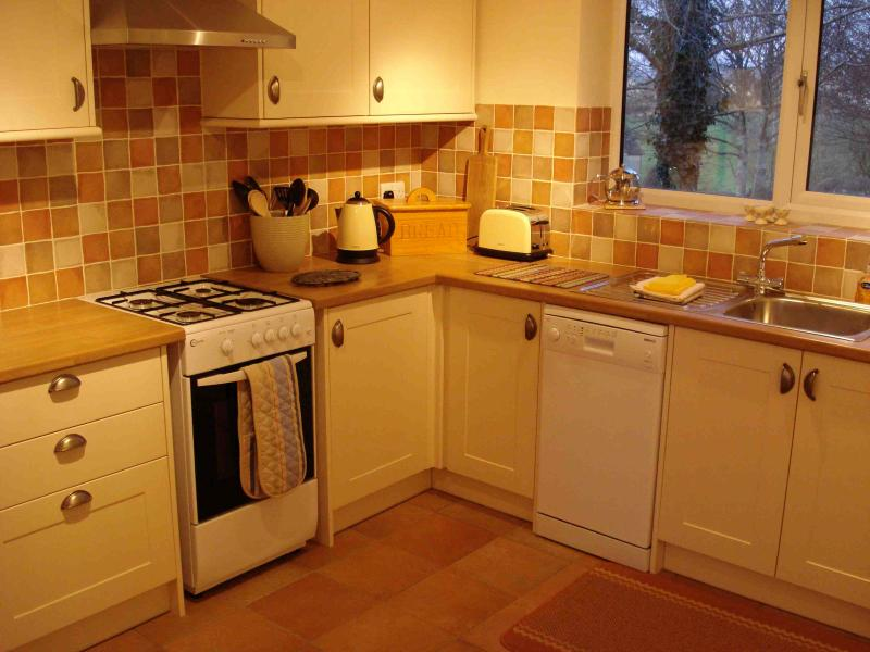 Modern, well equipped, good sized separate kitchen with country, retro feel. Looks out across field