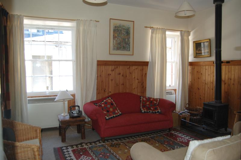 Cosy lounge with wood-burning stove, wifi and tv.
