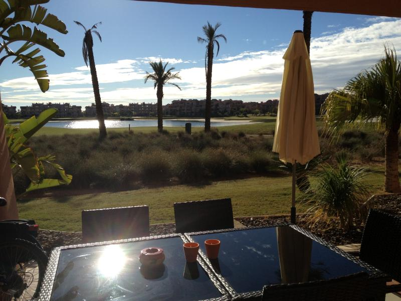 View from the covered terrace on the lake of the golf