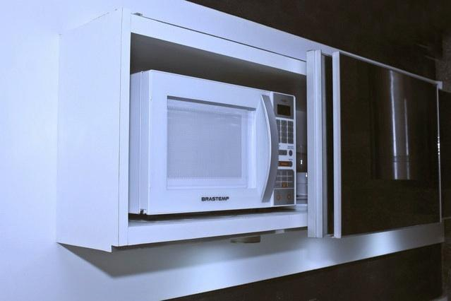 Microwave within the cabinet - leaving the bench free.