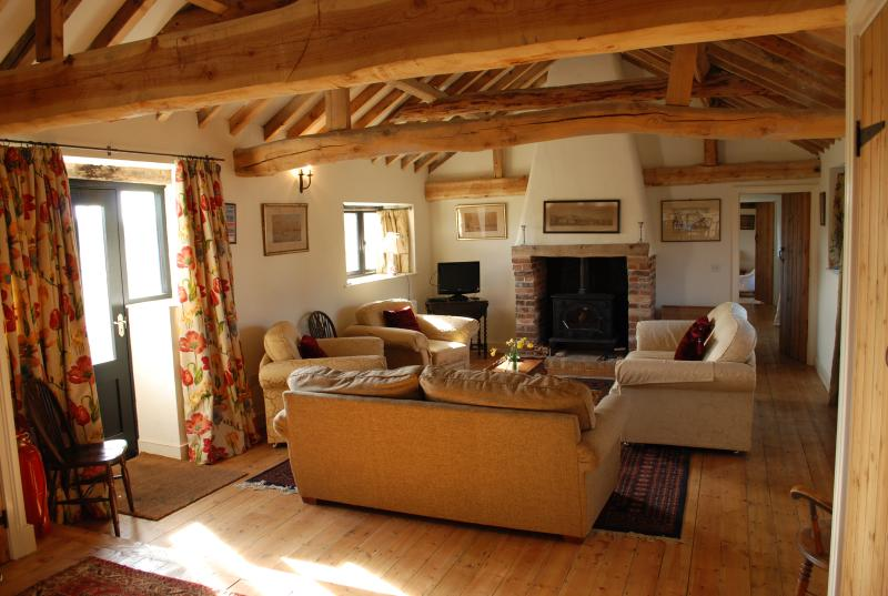 The Sitting room with cosy woodburner