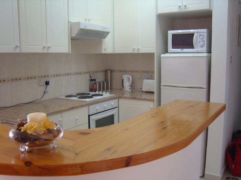 Kitchen. Fully equipped with hob / oven, w / machine, fridge, microwave, toaster etc.. Self catering