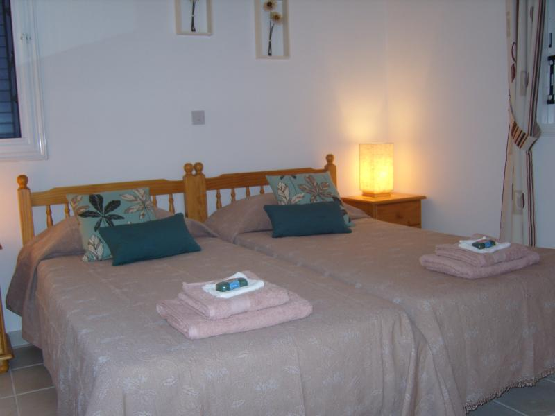 Bedroom 1. Both Bedrooms have single beds with bedside lockers & lamps. Large storage areas in b