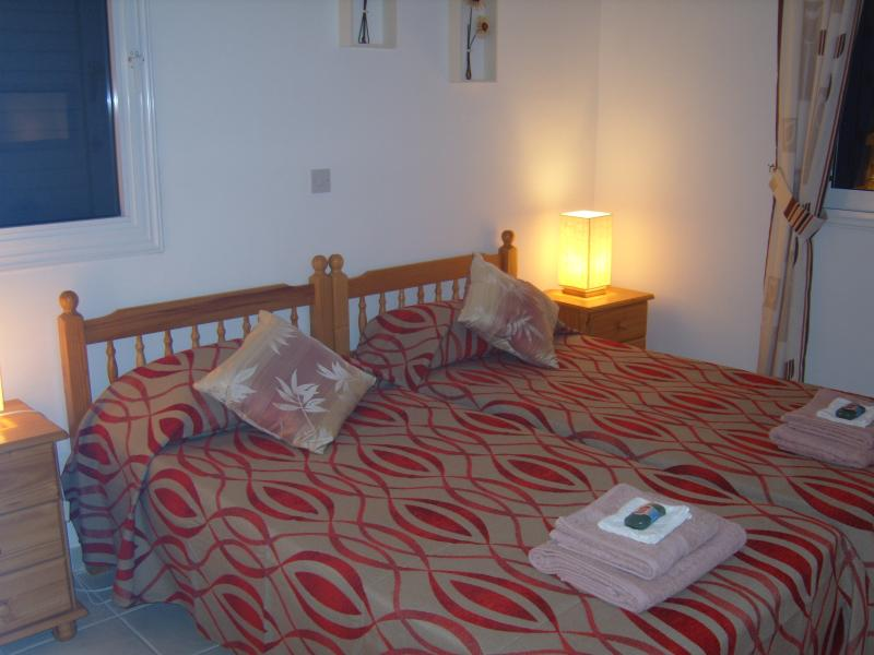 Bedroom 2. Both Bedrooms have single beds with bedside lockers & lamps. Large storage areas in b