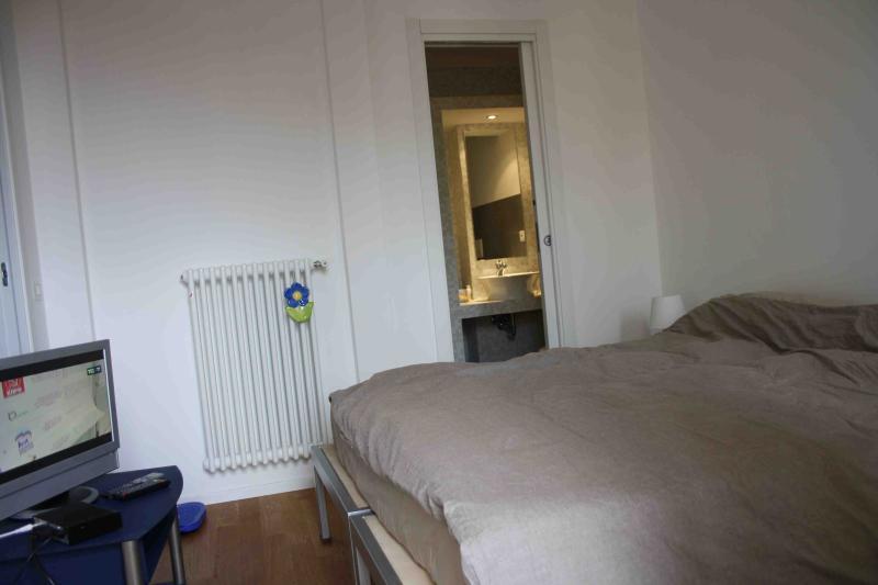 bedroom, with bathroom, TV set, wardrobe, balcony with views