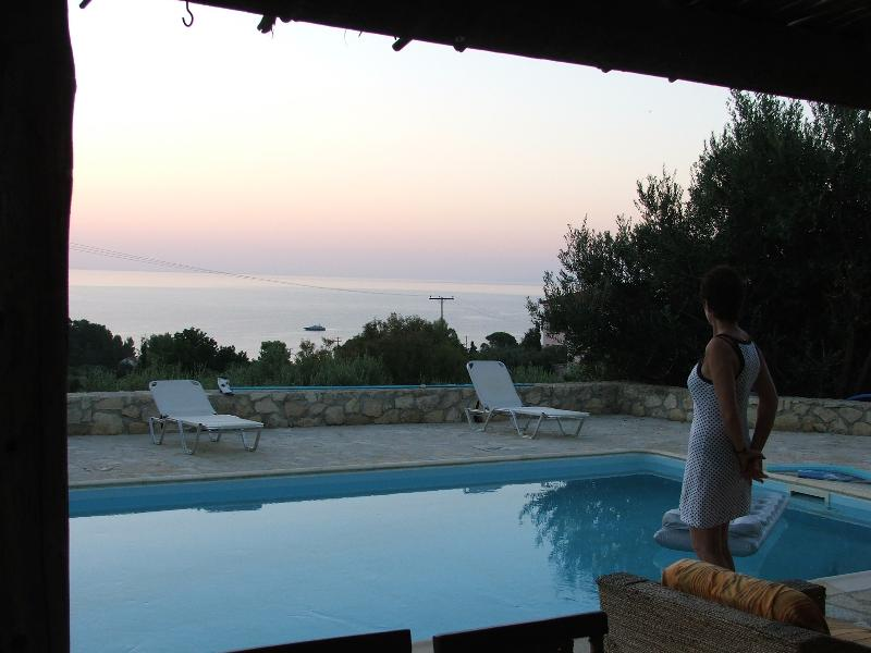 Dawn view across pool patio and bay