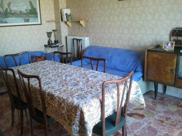 dining room with two sofas, one of which read