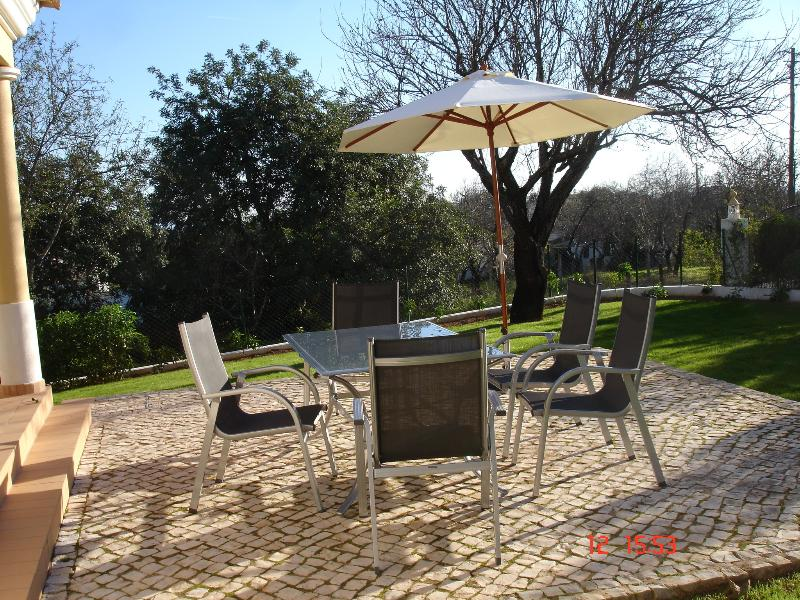 Patio area at rear of the property for al fresco dining, table and chairs available