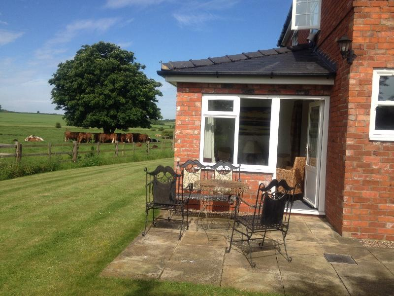 Eat breakfast al fresco on the patio from the garden room whilst watching the cows and calves