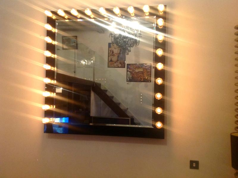 Extra large Hollywood style mirror in living room. Super cool feature when lit up at night.