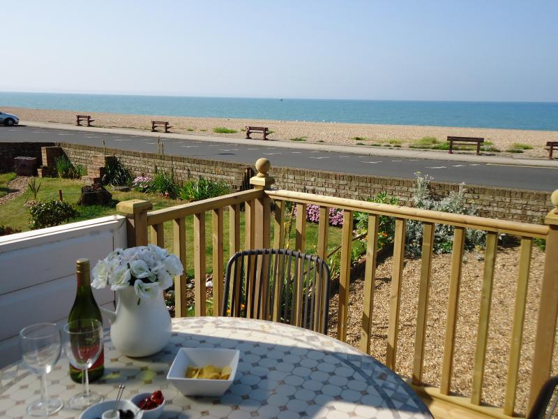 Enjoy a glass of wine on the sun-drenched deck overlooking Seaford Bay.