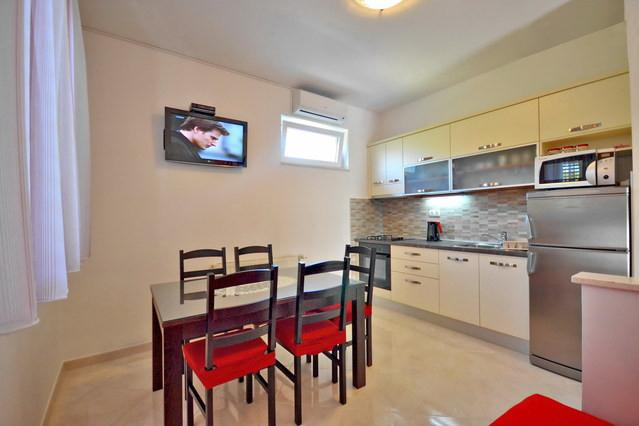 Kitchen with dinning room of AP 4+1 West