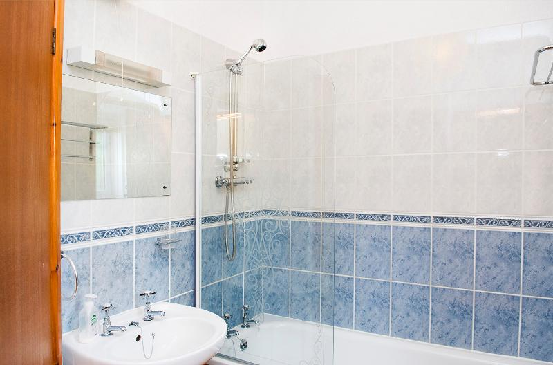Bathroom with and and shower