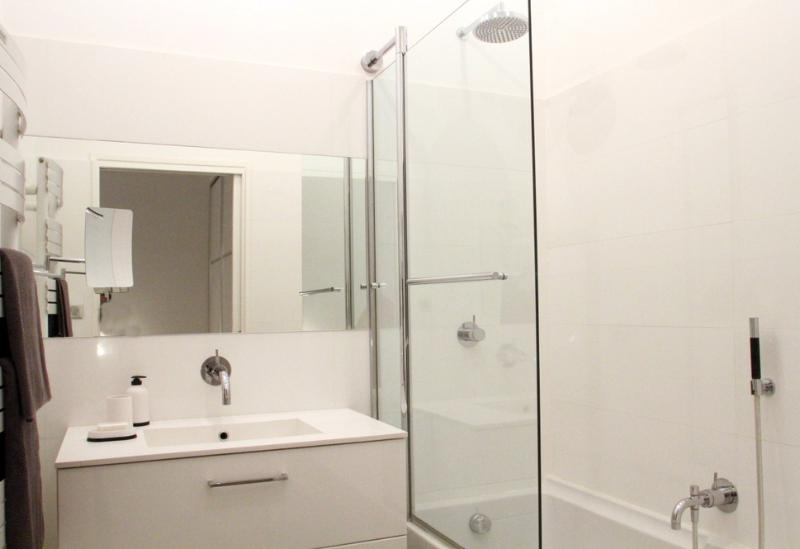 There is a shower/bath and a separate toilet