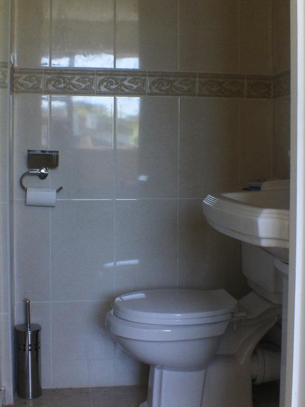 en-suite bathroom with bedroom 3 (electric shower, toilet, whb)