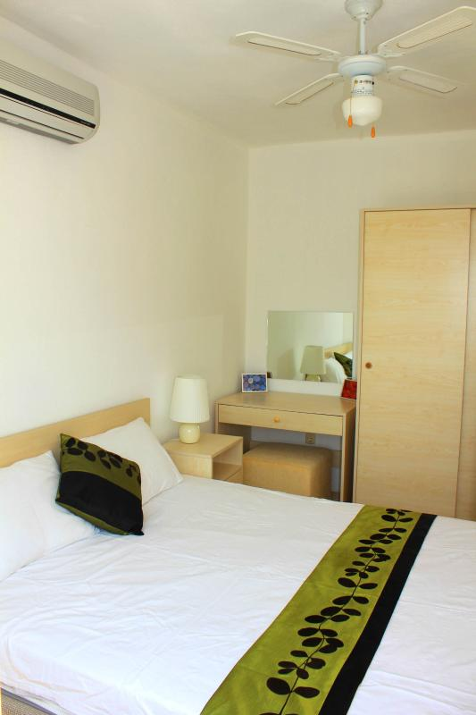 One of the bedrooms - all rooms fitted with fans and airconditioners