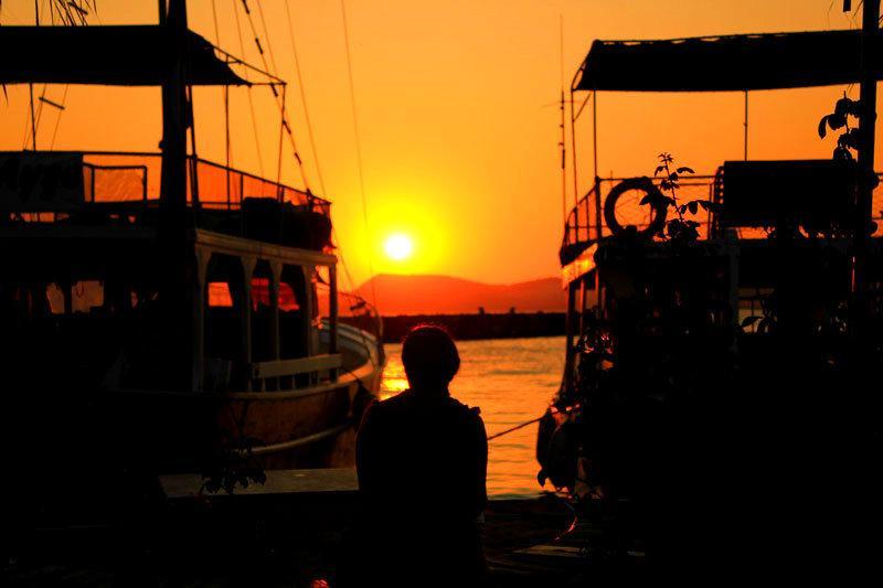 Sunset between the boats on Gulluk esplanade