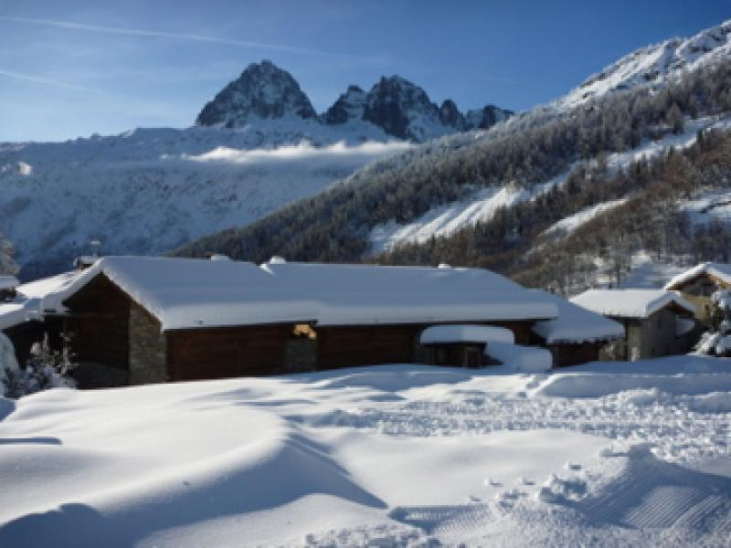 Exterior of chalet from piste in winter