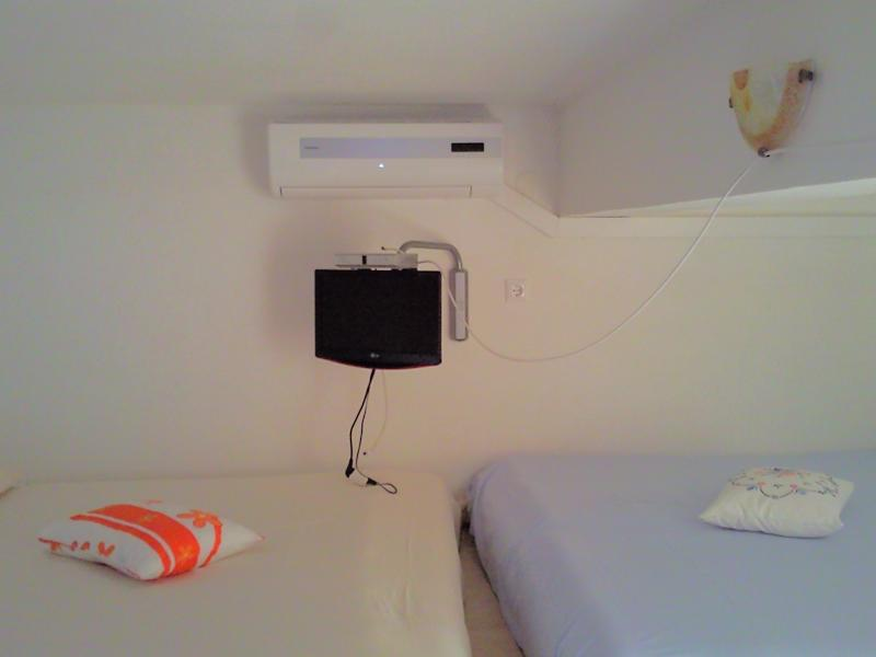SAT TV and air conditioner with two double beds
