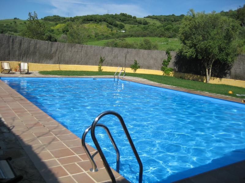 The large swimming pool is set in beautiful surroundings