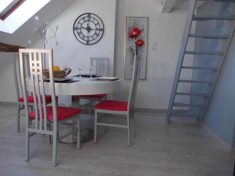 Dining area. Loft access through stairs towards room with bed 190 x 140