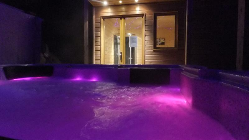 Luxurious Hot-Tub and Sauna, Relax with a glass of bubbly after a great day in the mountains