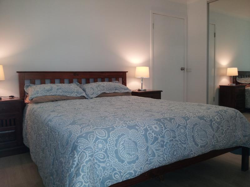 FIGS 1 Bedroom with queen bed and wardrobe