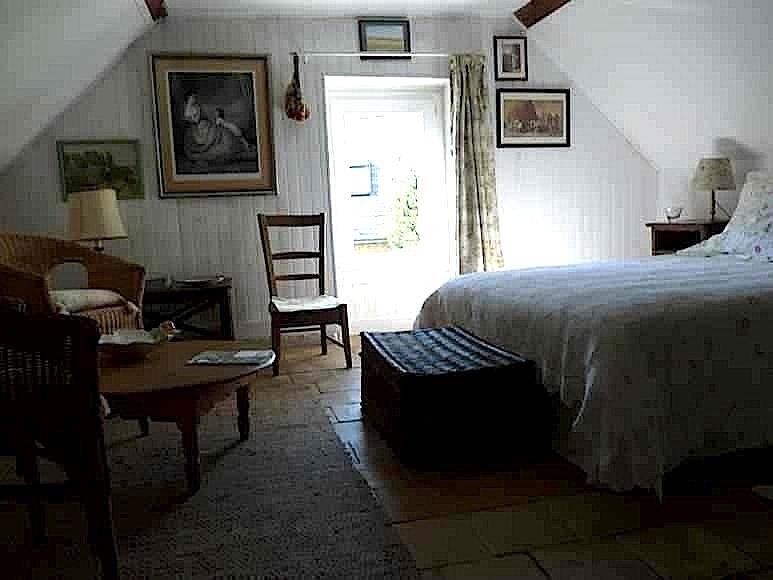 La chambre romantique avec son petit salon