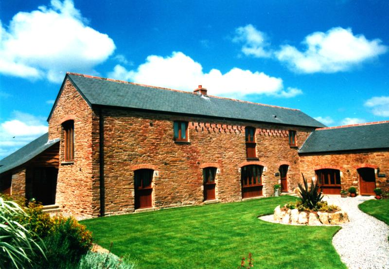 The spacious Roundhouse has 4 bedrooms set in a courtyard of 3 barns with stunning rural views.