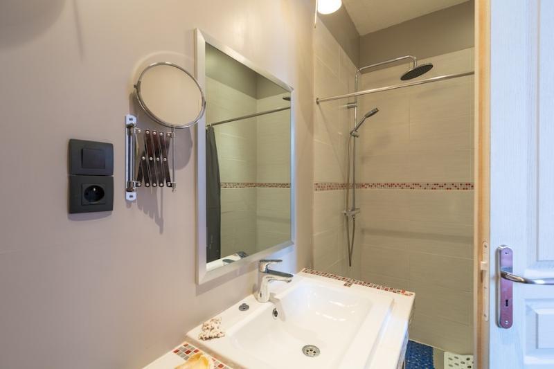 Rain shower in the ensuite bathroom with underfloor heating and towel heaters.