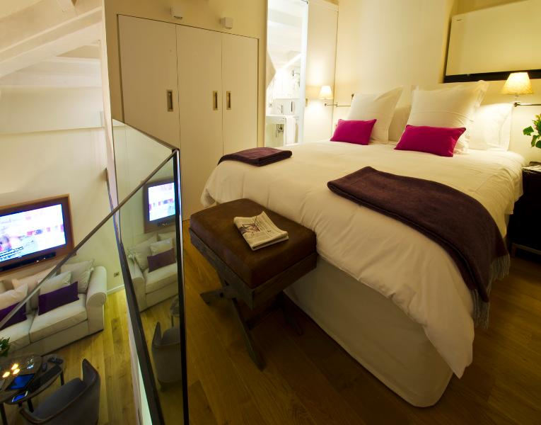 Penthouse Suite sleeping area and bathroom are located one flight of stairs above and overlook the l