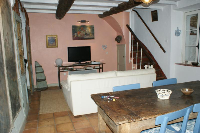 The living area with sofa and dining table