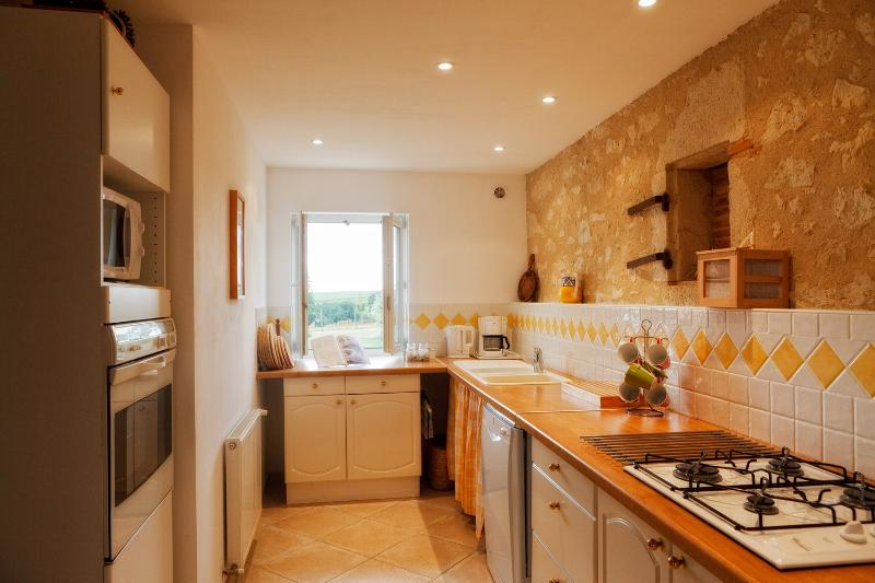 Bright kitchen and its original stone features.