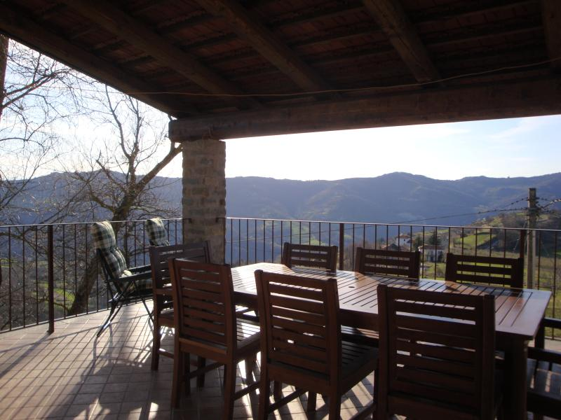 Terrace with views of the Langhe hills and snow capped Alps