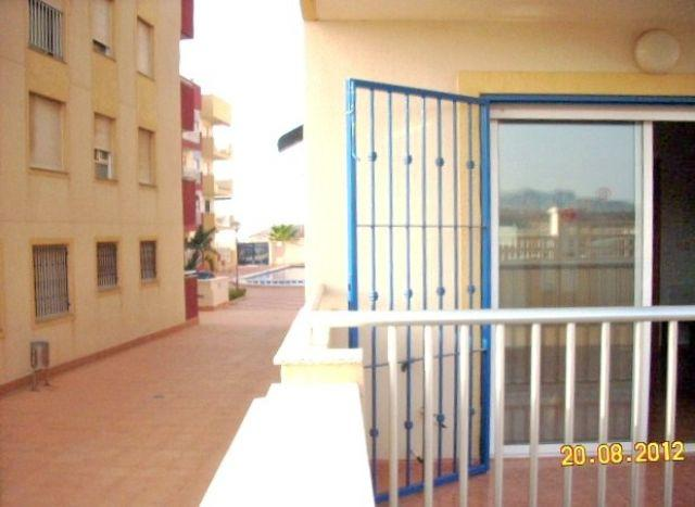 The terrace of our apartment. You can see the community pool in the back of the photo