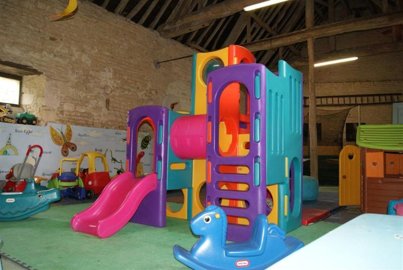 Playbarn with slides, ride-ons, trampoline