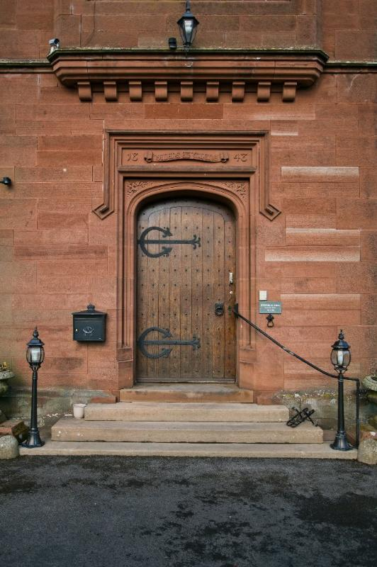 The grand oak entrance door at Staffield Hall