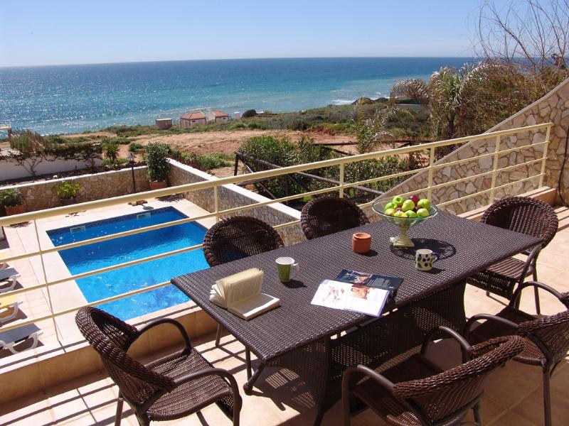 Panoramic sea views from top terrace, to Luz, table and chairs for alfresco dining.Peaceful area.