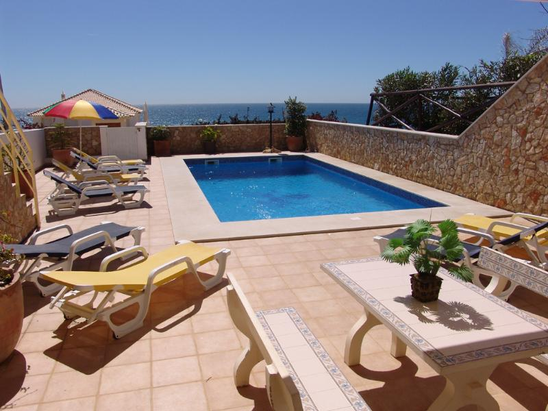 Lower patio terrace,large pool,sun loungers and brollies,table and chairs,BBQ and great sea views