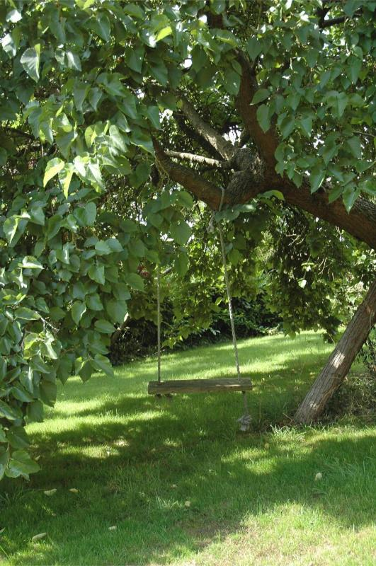 Enjoy a relaxing swing under the mulberry tree in your private garden!