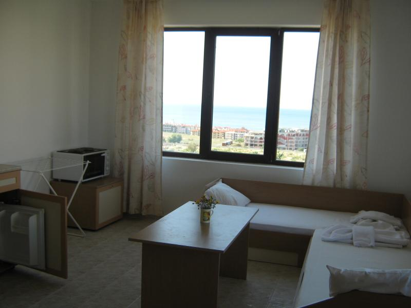 Room with two beds and seaview
