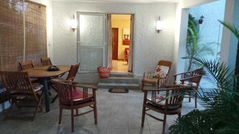The veranda is furnished with teak furniture