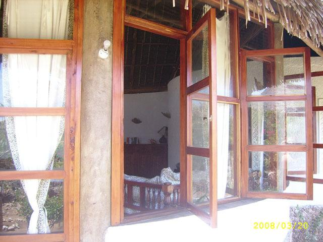 main entrance villa with windows that open to English.