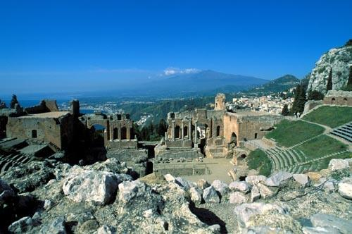 Greek theatre in Taormina and volcano Etna view