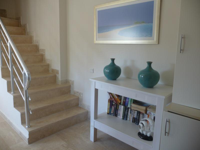 Cool, stylish entrance hall with stone staircase leading to first floor rooms