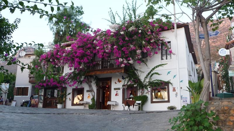 Kalkan old town, where historic buildings covered in bougainvillea are a feature of the landscape
